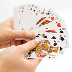 Hand holding fanned playing cards