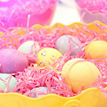 Bright colourful mini eggs in tissue paper basket