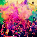 People throwing coloured powder with joy