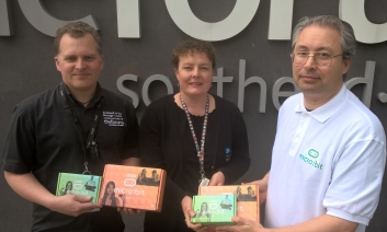 Andy Melder from Southend Tech handing over Micro:bits to Southend Libraries at the Forum to Joe Passingham, Library Manager and Jo Robertson, Assistant Library Manager