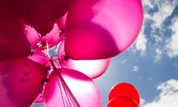 Pink Balloons in sunny sky