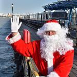 Santa waving from pier head