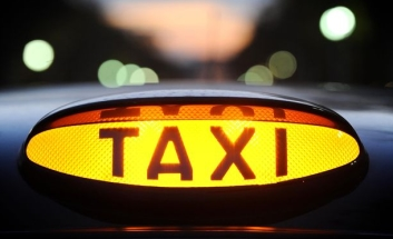 Close up of taxi sign