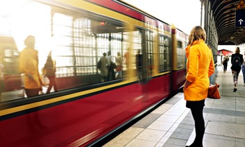 Woman in yellow coat on train platform