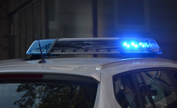Blue lights, top of police vehicle