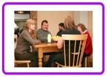 People sitting round a table - Residential