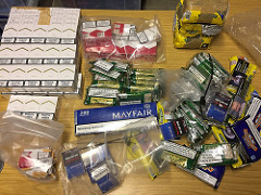Image of the tobacco and cigarettes seized.