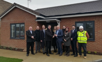 Various Councillors and builders from Marfleet and Blyth in front of newly built bungalow.