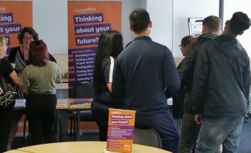 Young people talking to career advisers.