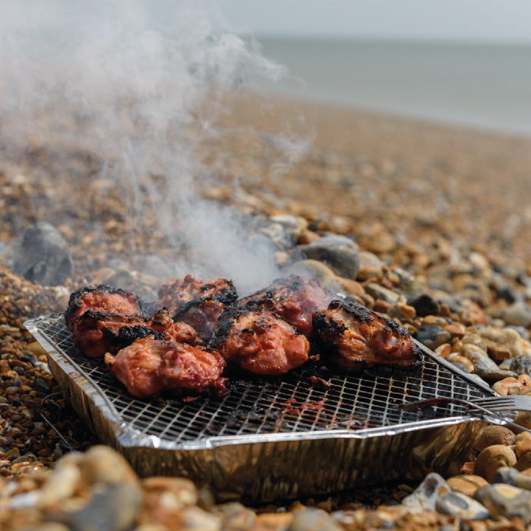 disposable barbeque on a beach
