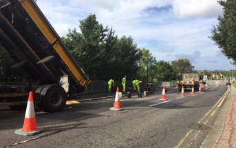 Contractors laying new road surface on Belton Way
