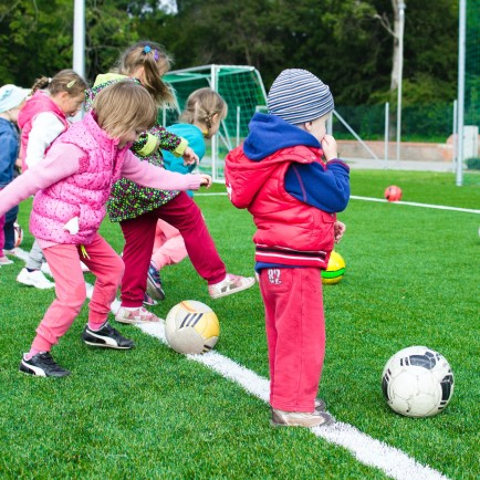 Children playing sports outside