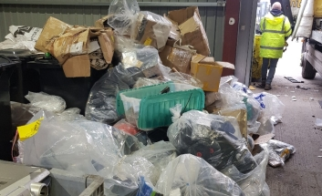Stacks of counterfeit items ready for disposal.