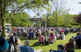Photo of Crowds enjoying the daisy bowlers performance on the bandstand in priory park