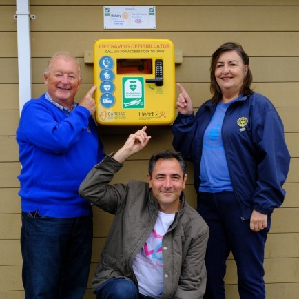 Left to right Bob Page Leigh Rotary Club, Karl Lansley, Carli Lansley Foundation and Loretta Andrews, Thorpe Bay Rotary Club, standing in front of a defibrillator.