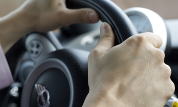 Hands on driving wheel