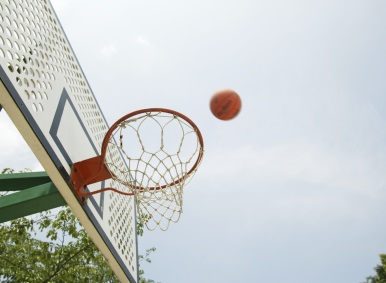 Basketball being thrown towards hoop