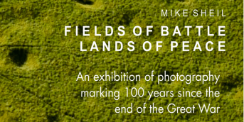 Image of battlefield with grass and text