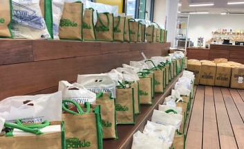 Bags,of food parcels lined up on shelves ready to dispatch