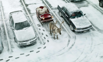 Illustration of Santa parking his sleigh and reindeer