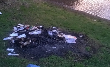 Fly tipping next to pond/lake