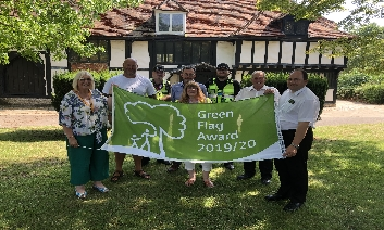 Cllr Carole Mulroney, Council Parks team, Volunteers from S.H.I.P and members of the Community Safety Team holding  Green Flag in a park