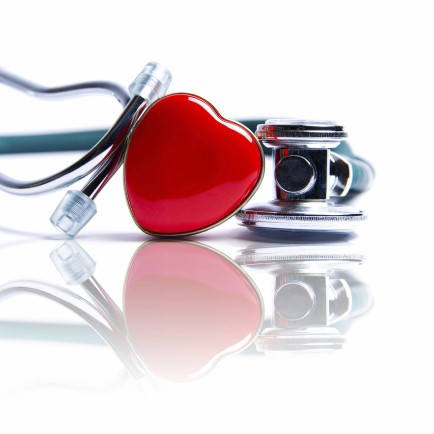 Stethoscope with enamel heart reflected in white surface