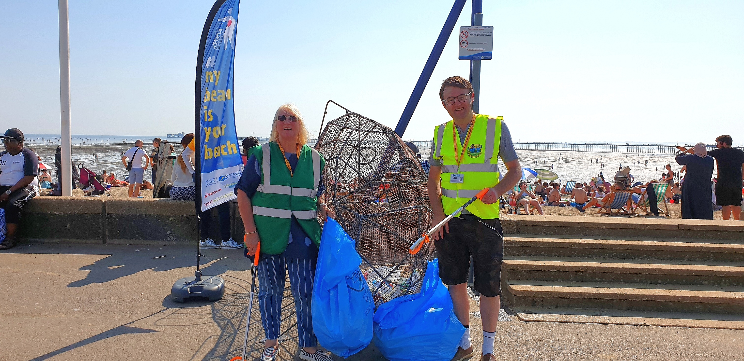 Cllr Mulroney and Cllr Thompson with the fish sculpture at City Beach.