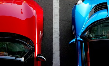 Red and Blue car parked side by side