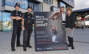 Police and Cllrs with See The Signs poster