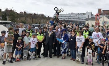 Mayor and large crowd of residents/children at Skate Park