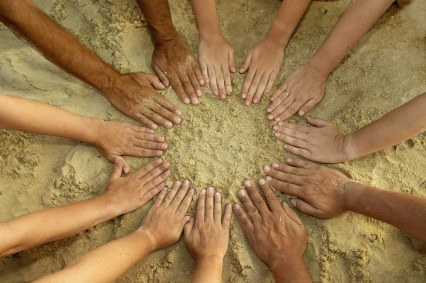 circle of hands in the sand