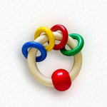 Wooden teething ring with blue, yellow, red and green rings on