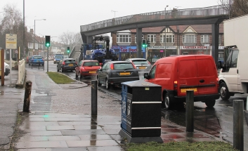 Vehicles using The Bell Junction on a rainy day.