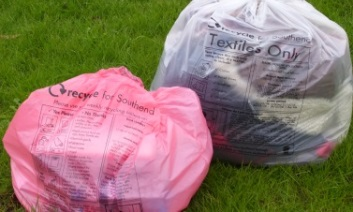 Pink and clear recycling sacks on a lawn